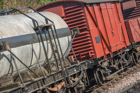 wagons: closeup of freight wagons on a railroad track