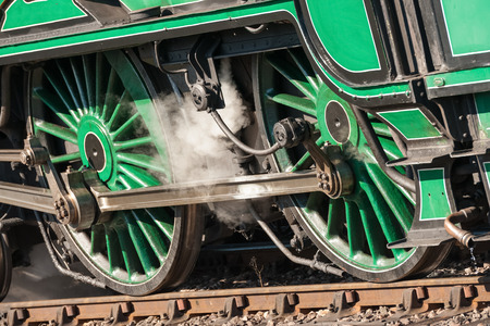 railway transportations: wheels and coupling rods on a vintage steam locomotive - shallow d.o.f. Stock Photo