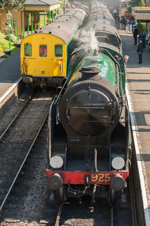 railway transportations: Ropley, UK - 19 September, 2015: Vintage steam and diesel locomotives at the Mid-Hants Watercress Railway station of Ropley, UK