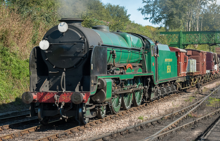 steam locomotive: Ropley, UK - 19 September, 2015: The Lord Nelson 850 vintage steam locomotive arriving at the Mid-Hants Watercress railway station of Ropley, UK