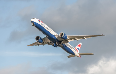 undercarriage: Heathrow, London, UK - January 28, 2016: British Airways Boeing 777 retracting its undercarriage on take-off from Heathrow Airport, London, UK Editorial