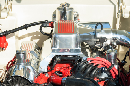 carburettor: automotive engine bay parts on a high performance vehicle