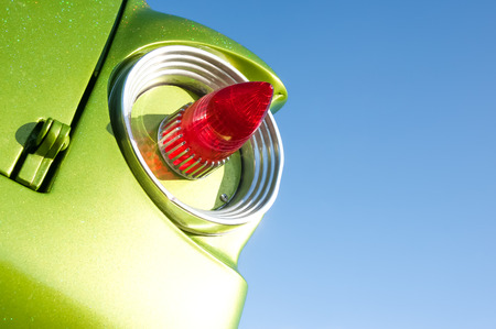 taillight: retro vehicle tail-light on a blue sky background Stock Photo