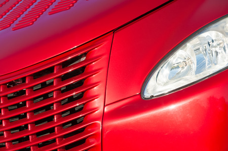grille: cherry red vehicle grille in bright sunlight Stock Photo