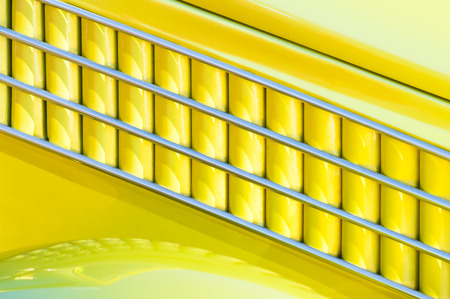 artdeco: yellow and chrome art-deco style vehicle panel abstract