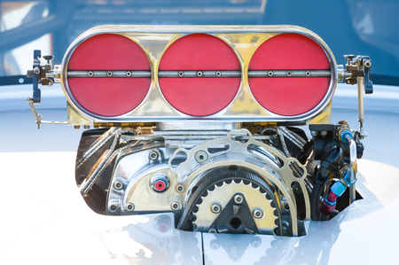 carburettor: powerful blower supercharger on a high performance racing vehicle Stock Photo