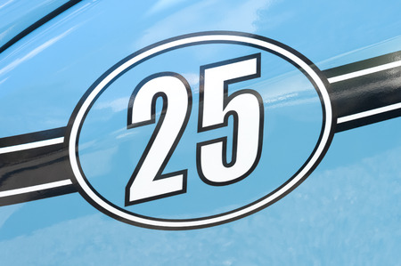 motor cars: competition race number 25 on a light blue metallic panel Stock Photo