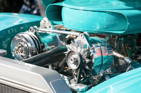 carburettor: turquoise and chrome engine bay on a high performance vehicle Stock Photo