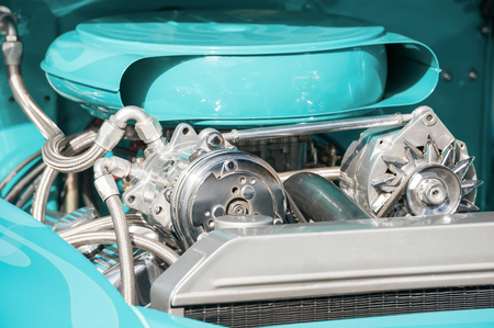 carburettor: chrome and turquoise engine bay on a high performance vehicle