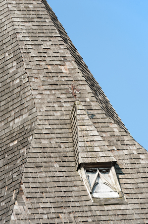 belfry: derelict wooden slate belfry tower detail