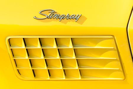 horsepower: Rushmoor, UK - March 25, 2016: Vehicle badge closeup of a Corvette Stingray muscle car. Editorial
