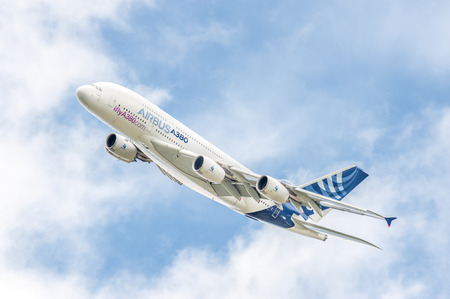 Farnborough, UK - July 16, 2016: Airbus A380 on a low-level banked turn prior to landing at an aviation trade event.