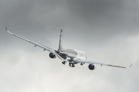 jet plane: Farnborough, UK - July 14, 2016: Airbus A350 XWB take-off from international aviation trade event at Farnborough airport