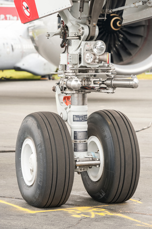 undercarriage: Farnborough, UK - July 15, 2016: Closeup section of an Airbus A350 nose wheel undercarriage on the taxiway at an aviation trade event in Farnborough, UK Editorial