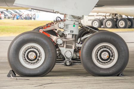 undercarriage: Farnborough, UK - July 15, 2016: Closeup section of an Airbus A350 undercarriage on the taxiway at an aviation trade event in Farnborough, UK