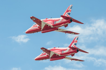 Farnborough, UK - July 17, 2016: Low-level flypast by the Red Arrows aerobatic display team at an aviation trade event at Farnborough, UK Editorial