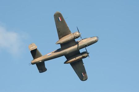 ww2: Farnborough, UK - July 17, 2016: Vintage B-25 Mitchell WW2 bomber aircraft in the skies over Farnborough, UK Editorial