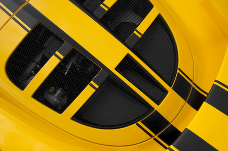 speedster: yellow and black luxury sports car abstract