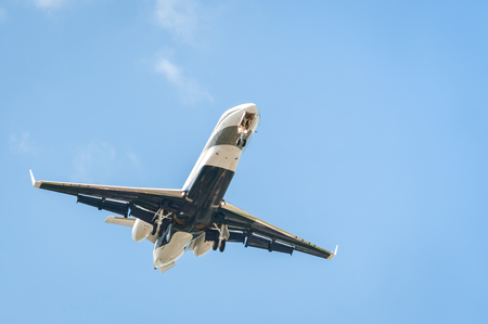 small corporate business jet on landing approach with copy-space Stock Photo