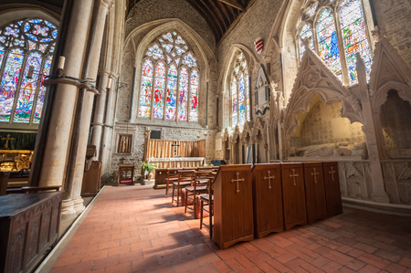 Winchelsea, UK - April 17, 2014: Beautiful interior and stonework architecture of the parish church of St Thomas in Winchelsea, UK Editorial