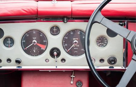vintage automobile dashboard and steering wheel