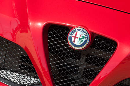 Laverstoke, UK - August 25, 2016: Closeup of a vehicle badge and grille on an Alfa Romeo sports-car.