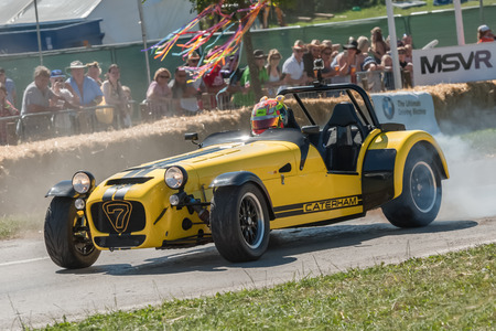 sportscar: Laverstoke, Hampshire, UK - August 25, 2016: Smokey wheel-spin by a Caterham 7 sports-car at the CarFest South event near Laverstoke UK, 2016 Editorial