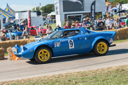 Laverstoke, Hampshire, UK - August 25, 2016: Classic rally-spec Lancia Stratos speeding down the course at the CarFest motoring event in Laverstoke, UK