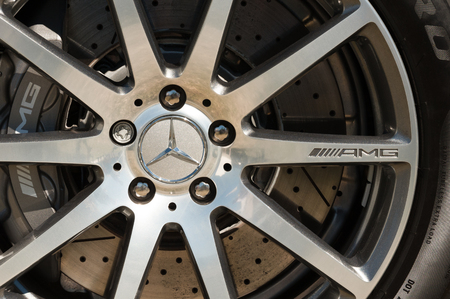 Laverstoke, Hampshire, UK - August 25, 2016: Closeup of the wheel and brake assembly on a luxury AMG model Mercedes automobile.