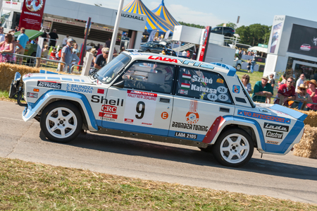 Laverstoke, Hampshire, UK - August 25, 2016: Classic rally-spec Lada 2105 driven by Szabo Laci speeding down the course at the CarFest motoring event in Laverstoke, UK