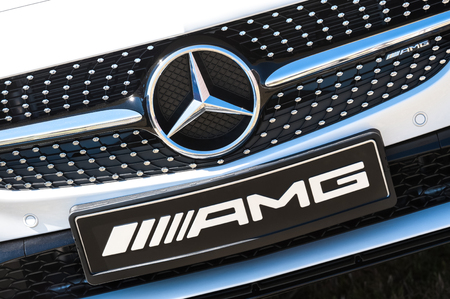 numberplate: Laverstoke, Hampshire, UK - August 25, 2016: Manufacturer nameplate and grille on a luxury Mercedes AMG at the CarFest motoring event in Laverstoke, UK Editorial