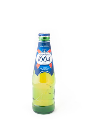 carlsberg: Yateley, UK - February 6, 2017: Bottle of Kronenbourg 1664 beer on white. A strong alcoholic beverage from the French Kronenbourg Brewery founded in 1664 but now owned by the Scandinavian Carlsberg Group