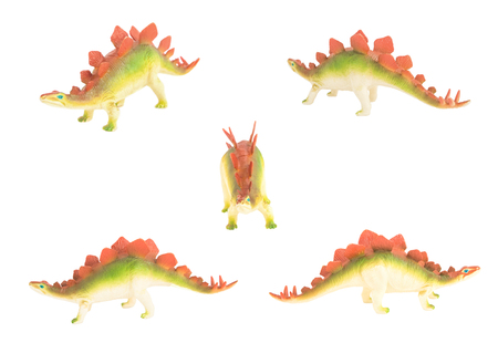 herbivores: toy stegosaurus dinosaurs isolated on white facing different directions
