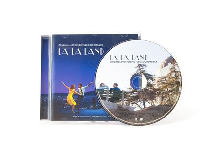 Yateley, UK - February 6, 2017: Soundtrack CD and artwork from multi Acadamy Award winning movie La La Land. The film starred Emma Stone and Ryan Gosling with music by Justin Hurwitz and lyrics by Benj Pasek and Justin Paul
