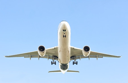 large passenger jet in a clear blue sky
