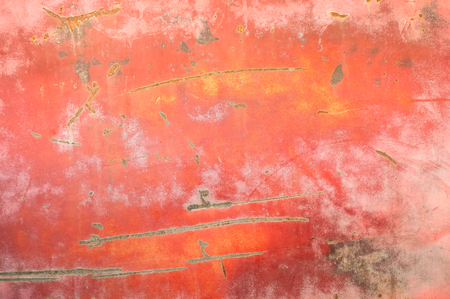 close-up of peeling paintwork and scratches on a rusting metal panel background Stock Photo