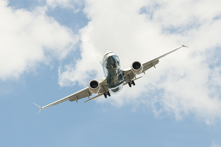 Farnborough, UK - July 16, 2018: Boeing 737 MAX on a steep angled landing descent to Farnborough Airport, UK
