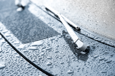 vehicle wiper blade and hood covered in raindrops