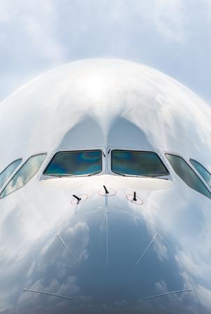 large passenger jet nose cone and cockpit window closeup