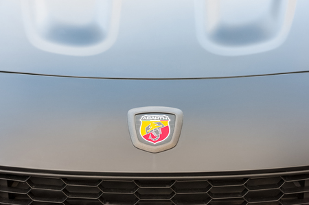 Hook, UK - January 1, 2019:  Close-up vehicle badge insignia on the hood of an Abarth sports-car automobile.