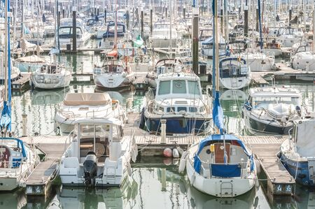 crowded boating marina with lots of yachts and small pleasure craft - no product identification or names