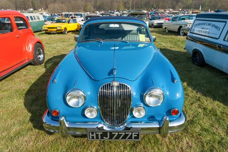 Vintage British Jaguar Mk2 car at a meeting of classic vehicles in Rushmoor, UK - April 19, 2019 新闻类图片
