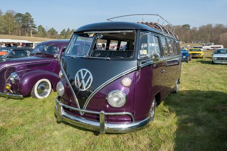 Fully restored purple split-screen Volkswagen Camper at a meeting of classic vehicles in Rushmoor, UK - April 19, 2019 Editorial
