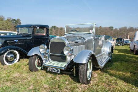 Fully chromed custom restoration of a Ford Model A at a meeting of vintage vehicles in Rushmoor, UK - April 19, 2019