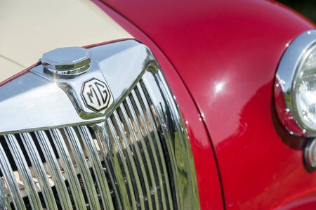 Closeup of a British made MG sports car and vehicle badge in Rushmoor, UK - April 19, 2019 Editorial