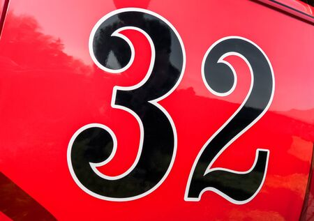 number 32 on the door panel of a red race car Standard-Bild