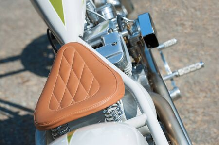 stitched leather saddle on low rider chopper motorcycle