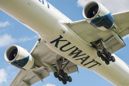 Kuwait Airways Boeing 777 landing gear closeup on approach to London, Heathrow, UK - May 12, 2019