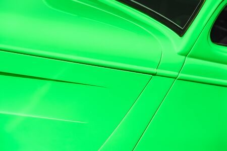 vivid emerald green vehicle panel abstract background