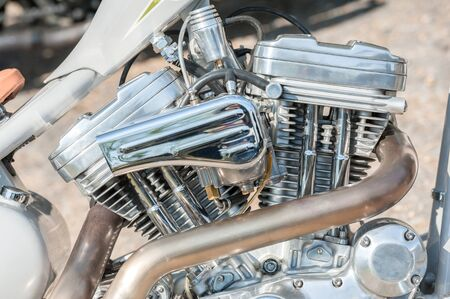 powerful chromed motorcycle engine and exhaust pipe closeup